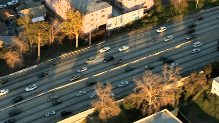 пригород : Aerial footage of Los Angeles freeways and suburbs.  Shot using a Sony EX3 camera.  Be sure to check out my other low cost high quality clips.  Most clips under $25.00 or less.
