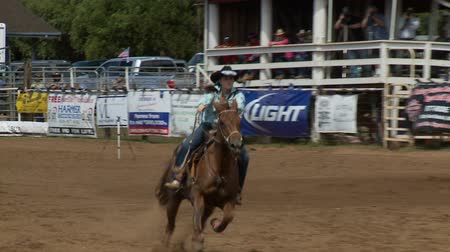 wyscigi : Rodeo Cowboys - Cowgirls Barrel Racing  in Slow Motion
