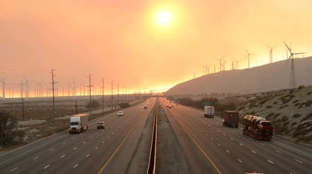 camionagem : the 10 freeway with smoke from a forest fire in the distance Stock Footage