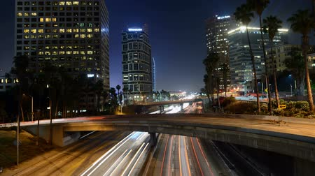 camionagem : Busy Harbor Freeway in at Night - Downtown Los Angeles Stock Footage