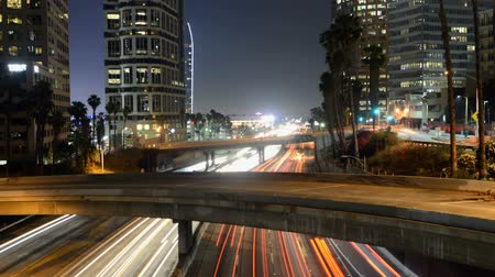 motorkerékpár : Busy Harbor Freeway in at Night - Downtown Los Angeles Stock mozgókép