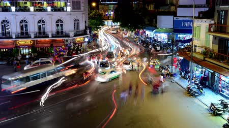 csík : Time Lapse of Busy Downtown Traffic Circle at Night -  Hoan Kiem Lake  Hanoi Vietnam