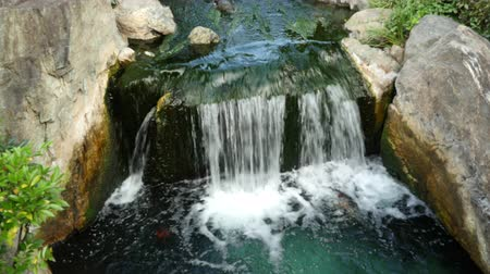 пруд : Waterfall runs into a Koi pond at Sensoji Temple Tokyo Japan