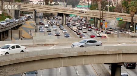 motor vehicle : Zoom Out  Overhead Time Lapse View of Traffic on Busy Freeway in Downtown Los Angeles California Stock Footage