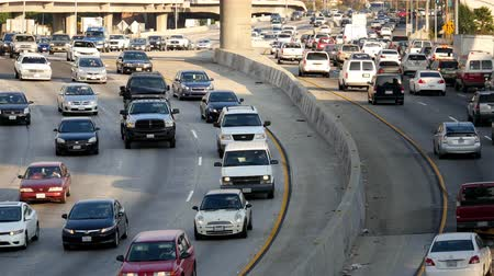 jam : Overhead Time Lapse View of Traffic on Busy Freeway in Downtown Los Angeles California Stock Footage