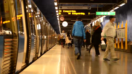 exiting : People Exiting Subway Car onto Station Platform-  Stockholm Sweden Stock Footage