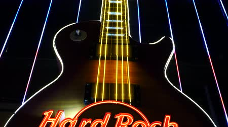 flaming : Pan Down of Hard Rock Cafe Sign - Las Vegas