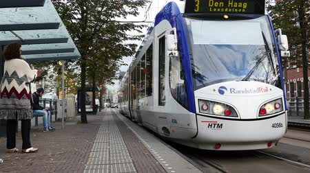Dutch Tram Pulling into Street Station -  Amsterdam Netherlands