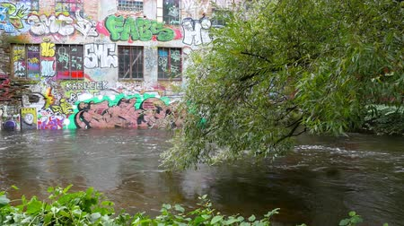 runoff water : River Flows Past Graffiti Painted Building in Oslo Norway Stock Footage