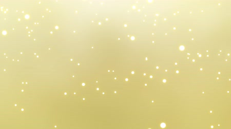 Animation of confetti falling with shiny white snowball on gold backdrop. Abstract soft background Stok Video