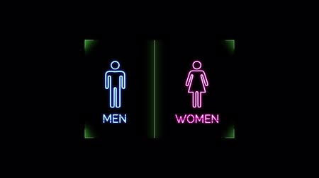 Neon light glowing blinking of toilet sign with blue man and pink woman symbol on black background Stok Video