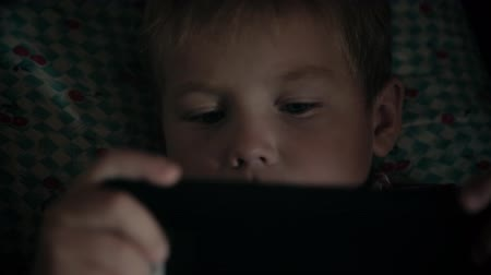 Close-up of kid face looking at tablet computer