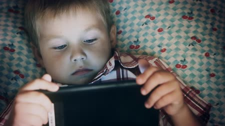 Close-up of boy face looking at tablet computer Wideo