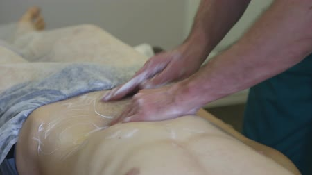 манипуляция : Massagist making abdominal massage for man