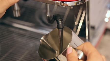 Barista preparing fresh milk for sweet cappuccino in coffee machine. Clouse-up. Wideo