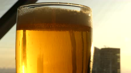 bira fabrikası : Beer mug sun rays sunset Stok Video