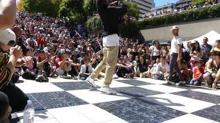 deli : Young black male dancing street Vancouver