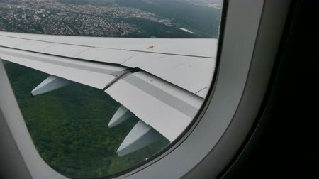 световой люк : Airplane leaning down window view