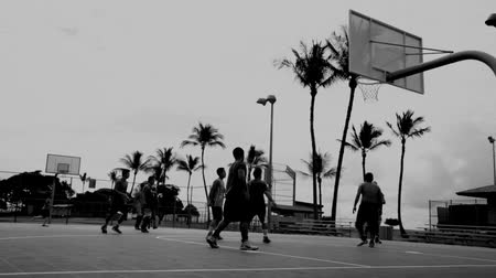 skorlama : Young males playing basketball low angle shot Stok Video