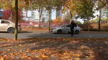 skate : Male skateboarding autumn road Stock Footage