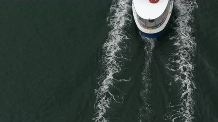 significar : Small ship moving water surface top view