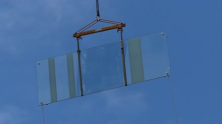 áttekinthetőség : Crane moving transparent glass window Stock mozgókép