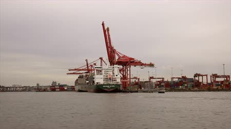 ithalat : Maritime transport harbor industrial crane moving shot