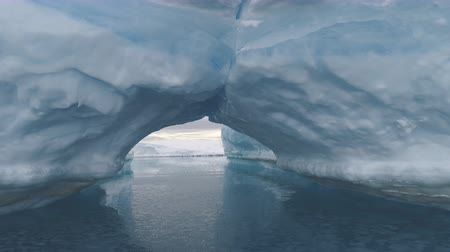 Arch Between Icebergs. Antarctica Winter Landscape. Ice Mountains Connection Among Crystal Clear Ocean Water. Amazing Natural Phenomenon. Wilderness. Beauty Of Virgin Nature. 4k Footage.