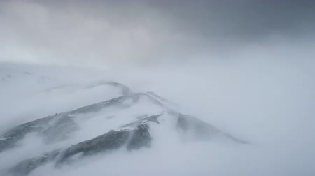 Blizzard Over Antarctica Mountains. Aerial Time Lapse Over South Pole. Harsh Wild Environment. Natural Polar Phenomena in Antarctic Midsummer. Winter Landscape In Grey White Tints. 4k Footage.