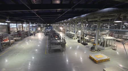 vezetett : Industrial interior, production of ceramic tiles, modern factory interior, Electrical Automated Guided Vehicles Platform Stock mozgókép