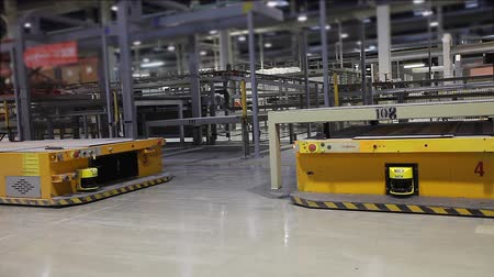 ceramika : Industrial interior, modern factory interior, Electrical Automated Guided Vehicles Platform, close-up Wideo