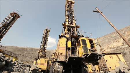 earthworks : The pit drill panorama, Industrial drilling rig in a quarry, large drilling machine Stock Footage