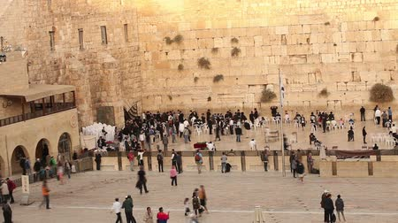 wailing : Jerusalem, Western Wall, Timelapse, people in the area, a lot of people, people pray at the stone wall, wailing wall, Israel flag, religion, top shooting, view from above