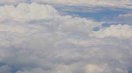 световой люк : View from airplane window, Beautiful snow-white clouds from the airplane window
