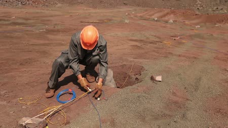 broca : Preparation of an explosion in the quarry, workers are preparing charges, iron mine, blasting in iron ore quarry, explosion in iron-ore quarry, Industrial exterior Stock Footage