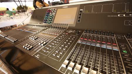 ajustando : Professional audio console in a concert, sound mixer console during a concert, audio Mixer, control engineer, selective focus, audio mixer, shallow depth of field Stock Footage