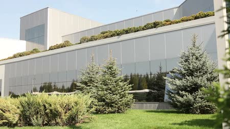 ceramika : Modern office building, Exterior of modern storehouse or factory, green plants, exterior of the modern plant, building exterior, with air, industrial exterior, modern factory
