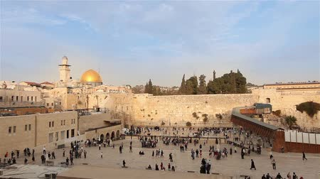 wailing : Israel, Jerusalem western wall. The Western Wall, Wailing Wall, Jewish shrine, old city of Jerusalem, Orthodox Jews pray, religion, Timelapse, zoom, panorama Stock Footage