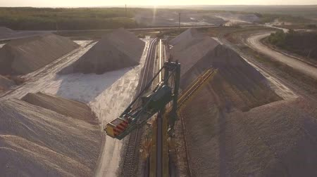 яма : Aerial view, machinery working at clay quarry, heavy loaders, large trucks, bulldozers, excavators, Sand quarry, Mining, The train takes raw materials from the quarry, Large clay warehouse
