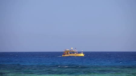 acrobata : A yellow pleasure boat in the sea, a yellow submarine in the sea, Sea Resort, Pleasure boat with a transparent bottom