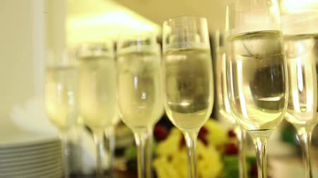 faház : Sparkling champagne wine in glasses in front of the warm fireplace. Close up