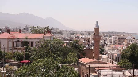 mussulman : View of the Arab city by a mosque, The Arab city near the sea, the minaret in the Arab city, the Muslim, the Muslim city, east, Arabian town near the sea, against the backdrop of mountains, top view Stock Footage