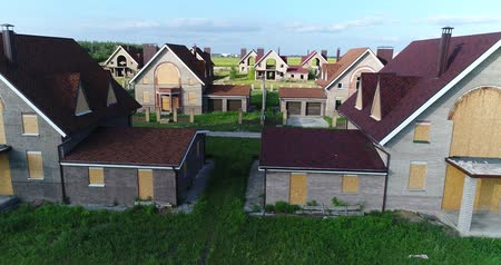 yanliŞ : Unfinished cottages, abandoned cottages, a cottage town, several houses, Green lawn, View from above, aerial