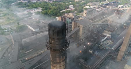 Industrial area top view, View of the industrial object, Courtyard of a factory, Aerial view, Smoke and fire, environmental pollution, environmental pollution, ecological disaster, panoramic view, 4K Wideo