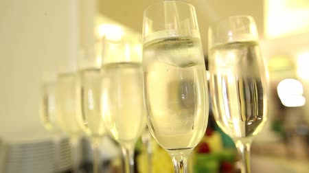 Close up of champagne glasses with celebration background.