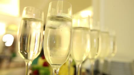 Close up of champagne glasses with celebration new year on the background. Wideo