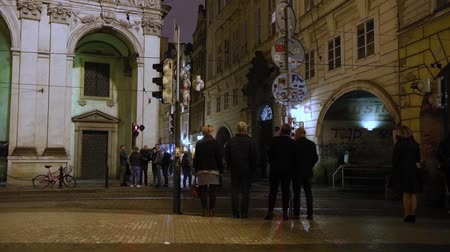 Night Prague, urban traffic on a night street, people cross the highway, Prague Castle, timelapse, Prague 2017