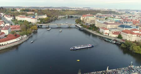vertically : Panoramic view from above to the city of Prague and Charles Bridge, tourists on the Charles Bridge