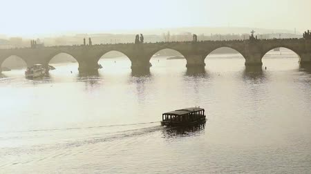 goes : old bridge over the river. Charles bridge, Prague