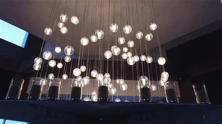 lobi : Hall of a hotel or restaurant, chandelier in the lobby, Chandelier hangs from the ceiling, creative, modern, interior, hotel or restaurant interior